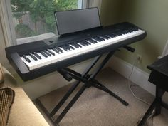 $350 - Casio Full-size Electric Keyboard Piano + Stand