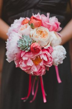 Succulents, peony, ranunculus, and garden roses. Gorgeous bouquet by bows and arrows.