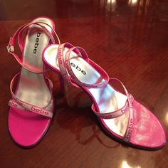 Bebe shoes size 7 Pink Bebe shoes with wrap around ankle straps little wear on bottom and little nicks on back as shown in picture but in good condition bebe Shoes