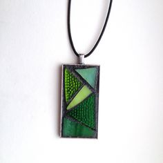 "Gorgeous abstract style green stained glass mosaic pendant. Silver-plated base with 18"" waxed cotton cord. Hand created by NiagaraGlassMosaics on Etsy"