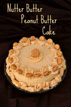 Nutter Butter Peanut Butter Cake on MyRecipeMagic.com.  Peanut Butter cake with peanut butter frosting, decorated with Nutter Butters! For only the serious peanut butter lovers.