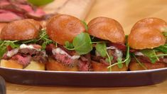 """Grilled Petite Filet Sliders - """"Petite filet is an affordable cut of beef, the tender of the shoulder. It is lean and buttery, and cooks in a quarter the time a large filet takes, and costs a fraction of the price. I serve it on crusty French rolls or buttery brioche rolls and top it as I do filet mignon, with horseradish sauce and watercress. YUM!"""" - Rachael Ray - {See the How to Video - Just Double Click}"""