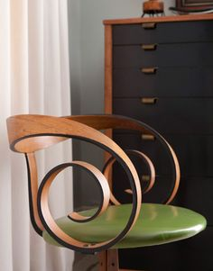 The mystery chair: Frank saw it in an antiques store, fell in love with it, and has no idea who designed it. The bureau behind it, however, is by Edward Wormley.   - HouseBeautiful.com