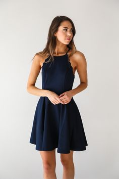 • Dark navy sleeveless fit and flare dress with scalloped detail • Available in S, M, L. Model is wearing a size small • 75% Cotton, 25% Rayon
