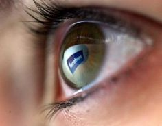 Close-up of eyeball with Facebook reflection - Chris Jackson/Getty Images News/Getty Images