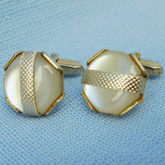 A pair of vintage cufflinks Gold coloured metal Round white discs - they look like mother of pearl but they just seem a little too perfect - I think