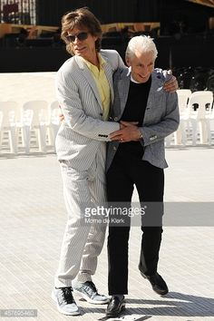 Mick Jagger of the Rolling Stones hugs fellow band member Charlie Watts during a photo call for the media ahead of their Australian tour at Adelaide Oval on October 23, 2014 in Adelaide, Australia.
