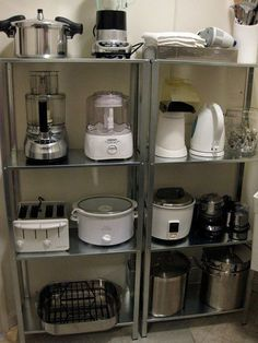 Organize small appliances on open shelving units - would be great to put in the pantry to reduce the look of clutter around the kitchen. Steel shelves are from Ikea.