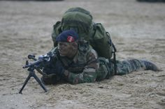 soldier laying on the ground-