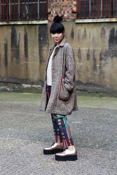 Folk tweed coat and polka dot top, Pleats Please trousers, Underground creepers