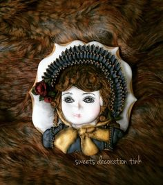 Antique porcelain doll cookie by sweets decoration Tink