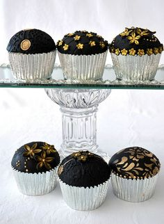 Gold and black anniversary cupcakes-    Chocolate and cherry with buttercream filling and antique gold embellished flowers