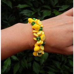 Yellow lemon charm bracelet ($57) ❤ liked on Polyvore featuring jewelry, bracelets, charm bracelet, yellow bangles, lemon jewelry and yellow jewelry
