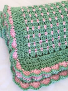 Crochet baby blanket pattern that has endless color possibilities and 2 border patterns for you to choose from. This beautiful baby afghan is very EASY to make. Cute jewels of color and sweet edging would be a welcome gift for a little one.   Crochet Patterns by Deborah O'Leary
