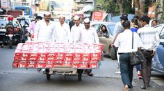 KFC launched its 5-in-1 meal box in India with an unusual collaboration with Mumbai's 125-year-old iconic food delivery network dabbawalas.