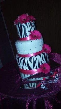 Hot pink and zebra wedding cake