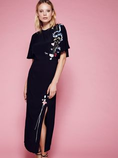 Louise Cape Midi Dress | Stunning kimono-inspired midi dress in a lightweight fabric featuring beautiful embroidery detailing. Wide flutter sleeves and an open back with adjustable tie. Dramatic slit on the front skirt.