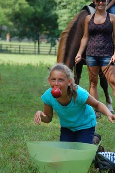We're getting ready for our annual backyard summer horse camp. I'm searching for more game ideas. Bobbing for apples, girls vs. horses, was a winner last summer.