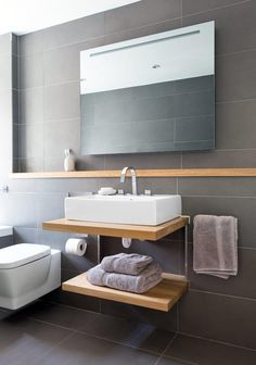 Gorgeous grey stylish bathroom with warm wooden elements to create a welcoming and blissful bathing sanctuary! VADO bathroom of the week featuring Geo 3 tap hole basin tap, what a beauty!