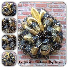 Saints wreath  Please visit www.Etsy.com/shop/CreatedByTerri  or www.facebook.com/CraftsandCreationsByTerri for updates and contest giveaways!!!