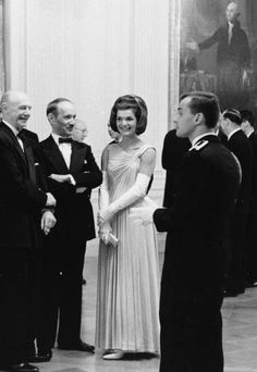 Jackie Kennedy - Hosting guests at a White House dinner honoring 49 American Nobel Prize winners in April 1962.