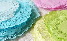 diy colored doilies: Add a thin layer of water to the bottom of a flat dish. Add several squirts of food coloring and mix. Drop in a doily. Leave it in for 10 seconds and carefully remove onto paper towels.  Cover with another paper towel and press to remove excess water and lay flat on a clean paper towel to dry.