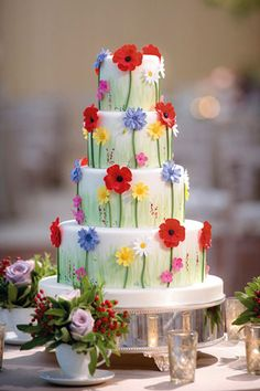 @Kathleen S S DeCosmo ♡❤ #Cake ❥ The four-tier chocolate and vanilla-raspberry cake, decorated with sugared wild flowers. The Cake Parlour (BridesMagazine.co.uk)