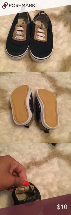 Old Navy Slip-On Shoes These are a navy blue and tan slip-on with white faux laces. Worn once or twice and in great condition. Old Navy Shoes Sneakers