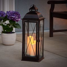 Salerno Triple Pillar Candle Lantern: statuesque & elegant, and sure to be a conversation piece in any home. Flameless candles operate on a 6hr on / 18hr off timer. #LED #CandleLantern #Lantern #DecorativeLighting