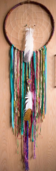 I love dream catchers. Although I like the classic ones better, I love the bright strings and dipped feathers!