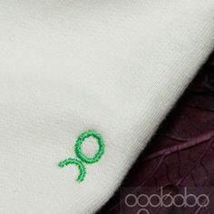 Close up view of our #torontoMade #embroidered logo!  #madeincanada #organicbabyclothes #gotscertifiedorganicthreads #babyapparel #sustainablebabyfashion #babylove