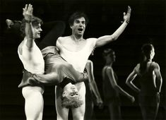 """MIKHAIL BARYSHNIKOV and RUDOLF NUREYEV give a """"upending"""" to musical comedy star GWEN VERDON as they practice for a guest appearance in a gala benefit for the Paul Taylor Dance Company at City Center 4/14. It is the first time the two dancers, preeminent in their discipline, have performed together. April, 1981"""