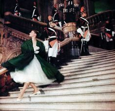 Audrey Hepburn wears a tulle dress and emerald green silk wrap in the movie Funny Face, 1956.