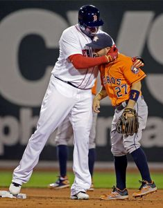 Hug it out: Boston Red Sox designated hitter David Ortiz hugs Houston Astros second baseman Jose Altuve after hitting a double during the third inning at Fenway Park, May 12 in Boston.