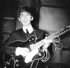 George Harrison was in 1963 Back Stage. Read more about George Harrison here at beatlesfansunite.com. Join for free and vote for your favorite Beatles.