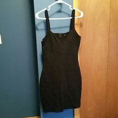 Express mini black simple cocktail dress In excellent condition. Exceptionally tailored with classy lines throughout the dress. Super comfortable and soft rayon and nylon. Zipper back Express Dresses Mini