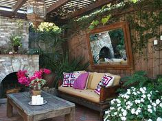 Love the idea of hanging mirror in outdoor space!