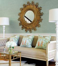 Love the paper, the sofa, the pillows, the table, and the figurine.   House of Turquoise
