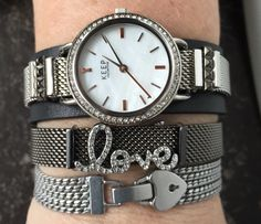 All about the metal... Multi chain, Hematite & silver mesh on black leather cuff.