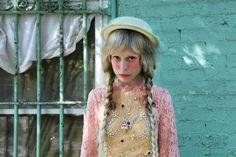 Hat by Jennifer Ouellette, dress by Sretsis,  necklace by Disaya.