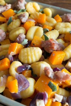 Sheet pan roasted gnocchi with butternut squash and sausage meat. A perfect easy one pan dish for the family. #freelancelife #sheetpan #familydinner