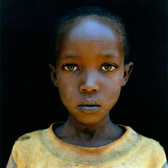 After the genocide began in Rwanda, wholesale killings by machete and gang rapes was part of everyday life. Now there is an entire generation of children fathered by rapists. Jonathan Torgovnik