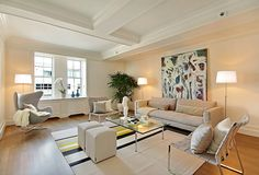 Contemporary Living Room with Box ceiling, Crown molding, Laminate floors