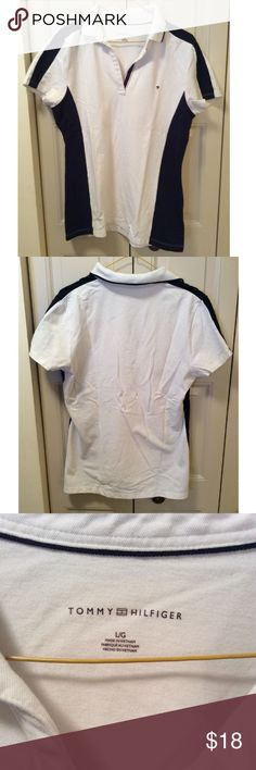 White and Navy Tommy Hilfiger Shirt White with navy stripes running down the sides. No buttons in the opening of the front. True to size. From a smoke free home. Tommy Hilfiger Tops
