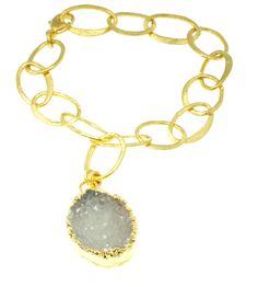 Pretty white druzy.  24k  gold dipped adjustable length bracelet.  On sale.  http://www.talismancollection.com/collections/nina-nguyen/products/details-coming-soon-39 Was 295, now $196