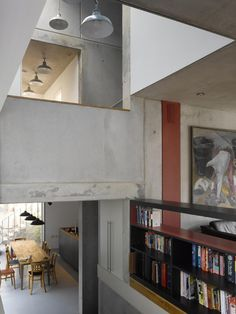 Zog House is modern prefab concrete family house built on a tight urban plot in Queen's Park London. It encapsulates the revolutionary Solidspace split-level that binds together the heart of the home: the three key living areas of eating, living and working.