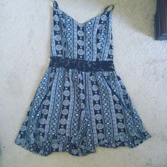 Adorable romper This cute Hollister romper is perfect for summer! it has crocheted flowers around the waist, zips on the side, AND has a criss cross back! Never worn. Hollister Dresses Mini