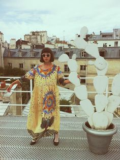 Penner, showing off her second dress on a Parisian rooftop.