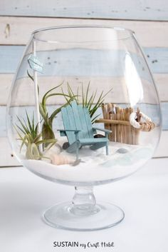 Any coastal-loving fairy needs a beachy mini garden to call home! We're sharing a full tutorial on how to make your own unique DIY air plant terrarium. -- Click image to read more details. #fairygardening