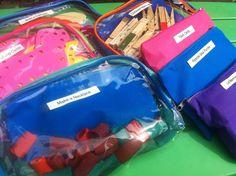 """Clear make-up bags, canvas zip bags, or mesh pencil pouches (for ring binders) to hold """"busy bags"""""""